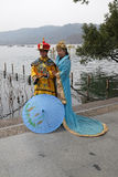 Girls posing in traditional Chinese costumes on the shores of West Lake in Hangzhou, China Stock Photos