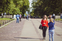 Girls posing on the waterfront. Young Girls, on a Sunny summer day posing for a picture on the waterfront in Petrovsky Park on Makarovskaya street in the city of Royalty Free Stock Photos