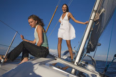 Girls posing on a yacht Royalty Free Stock Photos
