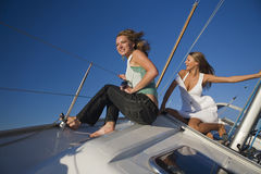 Girls posing on a yacht Stock Image