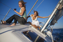Girls posing on a yacht Stock Photos