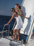 Girls posing on a yacht Royalty Free Stock Images