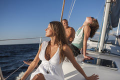 Girls posing on a yacht Stock Images
