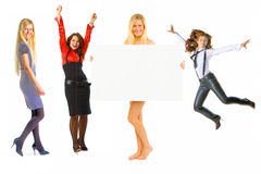 Girls and poster Royalty Free Stock Image