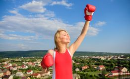 Girls power concept. Girl boxing gloves symbol struggle for female rights and liberties. Fight for female rights. Woman. Strong boxing gloves raise hands blue stock image