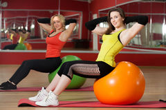 Girls practice on fitballs Royalty Free Stock Photos