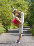 Girls practice on the way. Youngl girl standing on one leg royalty free stock photo