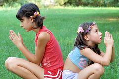 Girls in Prayer. Two sister in prayer , outdoors Royalty Free Stock Photos