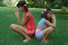 Girls in Prayer. Two sister in prayer , outdoors Royalty Free Stock Photography