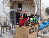 Girls prepare coffee at the finish for participants of the annua. Mi`ilya, Israel, December 22, 2017 : Girls prepare coffee at the finish for participants of the royalty free stock photos