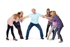Girls pull man's hands Royalty Free Stock Photography