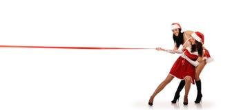 Girls pull red ribbon Stock Photos