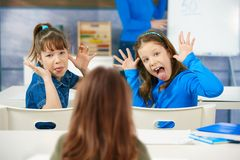 Girls pulling faces in class Stock Photography
