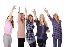 Girls pulling together hands up on white Royalty Free Stock Images