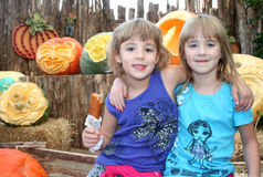 Girls at Pumpkin Festival Royalty Free Stock Images