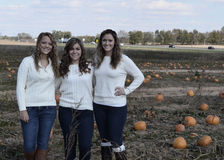 Girls in Pumpkin patch field Royalty Free Stock Images