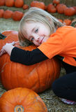 Girls and Pumpkins Royalty Free Stock Image
