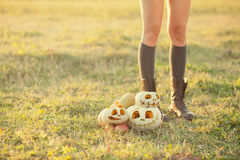 Girls with pumpkins Royalty Free Stock Image