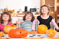 Girls with pumpkins Stock Images
