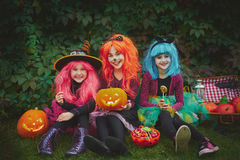 Girls with pumpkins and sweets Stock Photo
