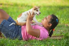 Girls and puppy in the garden royalty free stock image