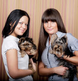 Girls with puppys. Two cute girls with puppys Royalty Free Stock Photos