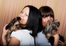 Girls with puppys. Two cute girls with puppys Stock Image