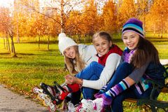 Girls putting on roller skates Royalty Free Stock Images