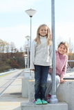 Girls on railing of dam Royalty Free Stock Photography