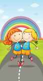 Girls and rainbow Stock Photography