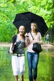 girls rainy rejoice to two weather Στοκ εικόνες με δικαίωμα ελεύθερης χρήσης