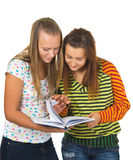 The girls read the book Stock Images