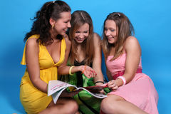 Girls read glossy magazine Stock Photo