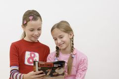 Girls / reading Stock Photo