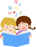 Girls reading the book Royalty Free Stock Images