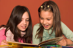 Girls reading book. In classroom Royalty Free Stock Photos