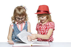 Girls reading a book Stock Photography