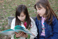 Girls reading book  Stock Photo
