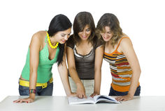 Girls reading a book Royalty Free Stock Image