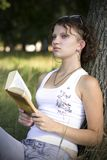 Girls reading book outdoors Royalty Free Stock Photography