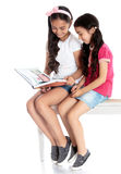 Girls reading a book Royalty Free Stock Photo