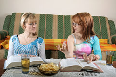 Girls reading books and discussing Royalty Free Stock Images
