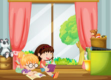 Girls reading books Stock Photos