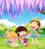 Girls reading books in the park at daytime Stock Photo
