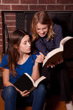 Girls reading books together Stock Photos