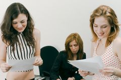 Girls reading exam results Royalty Free Stock Photo