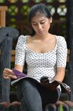 Girls reading magazine Stock Photos