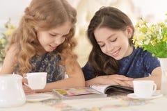 Girls reading magazine Royalty Free Stock Image