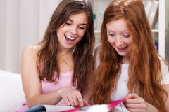 Girls reading magazines Royalty Free Stock Image