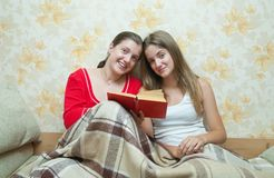 Girls with red book Royalty Free Stock Image